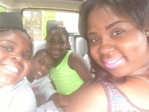 Bethel University student Shatrina Taylor with children Star, 11; Skylar, 9; and Tadarius, 13.